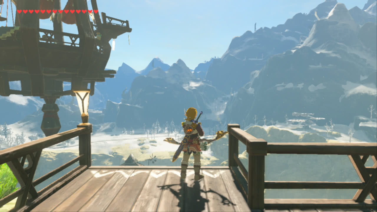 The player character looking contemplatively at snow-capped mountains from a wooden platform
