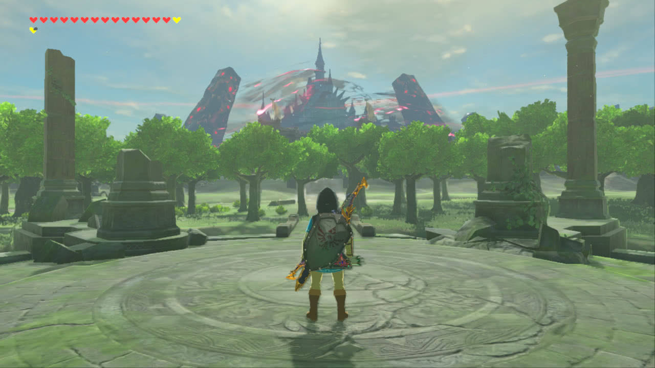 Link stands in the midst of some ruins facing away from the viewer, looking at Hyrule Castle in the distance surrounded by a malevolent aura.